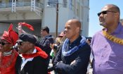Rev. Mpho Tutu, Archbishop Emeritus Desmond Tutu, Ambassador Patrick Gaspard, and Cape Town Consul General Teddy Taylor greet the Hokulea at a festive welcome ceremony at the V&A Waterfront.
