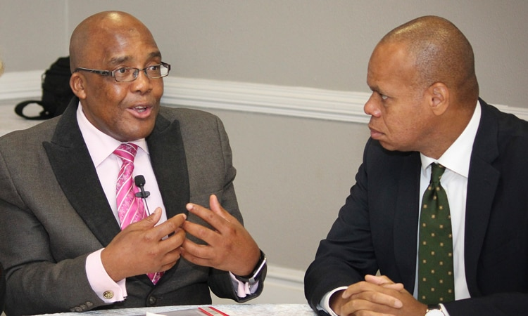 Ambassador Patrick Gaspard and South African Minister of Health Aaron Motsoaledi at the DREAMS launch, November 2015