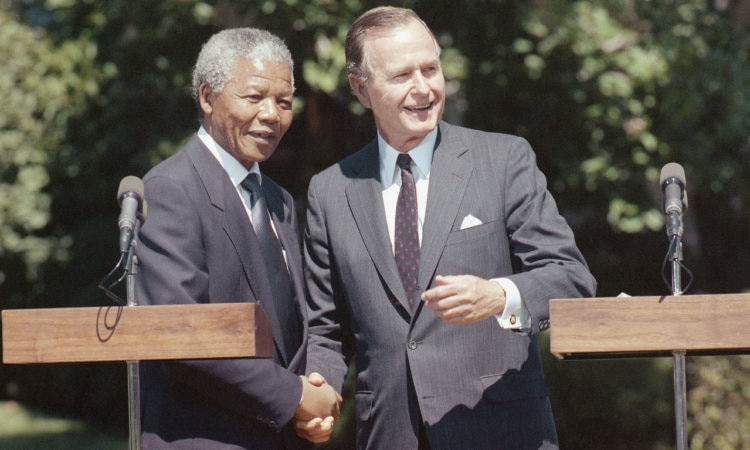 In 1990, President Bush met with Nelson Mandela during Madiba's first visit to the United States after his release from prison.